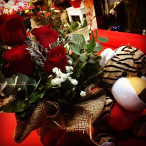 Flower arraignment with red roses and Valentine's bear